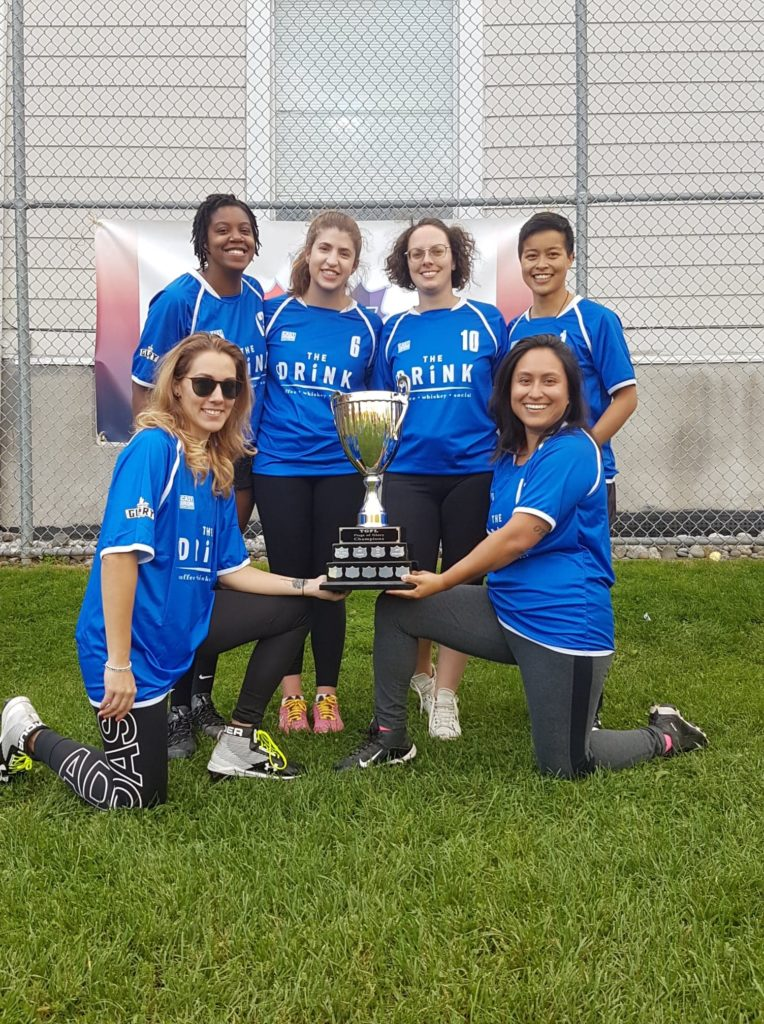image of 7 individuals around a trophy.